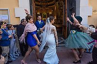 """Spain. Valencia Province. Valencia. Church """"Iglesia de Nuestra Señora de los Ángeles"""". Wedding of Gaetano & Raquel. The friends of the bride have invited her to dance a flamengo dance while she was getting out of church. Flamenco refers to musical traditions and more modern musical styles which have themselves been deeply influenced by and become blurred with the development of flamenco. It includes cante (singing), toque (guitar playing), baile (dance), jaleo (vocalizations and chorus clapping), palmas (handclapping) and pitos (finger snapping). Valencia (officially València) is the capital of the autonomous community of Valencia and the third-largest city in Spain. 15.12.18  © 2018 Didier Ruef"""