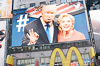 A billboard showed Alec Baldwin and Kate McKinnon on Saturday Night Live as Republican and Democratic presidential nominees Donald Trump and Hilary Clinton in Times Square in New York, New York, on Mon., Nov. 7, 2016.
