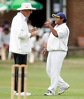Harrow captain H Gihn (R) gets involved in a heated discussion with the umpire during the Middlesex County Cricket League Division Three game between North Middlesex and Harrow at Park Road, Crouch End on Sat Aug 7, 2010.