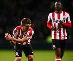 Nederland, Eindhoven, 2 februari 2013.Eredivisie.Seizoen 2012-2013.PSV-ADO Den Haag (7-0).Dries Mertens van PSV maakt een beweging alsof hij een golfclub vasthoudt nadat hij een doelpunt heeft gemaakt, 6-0.