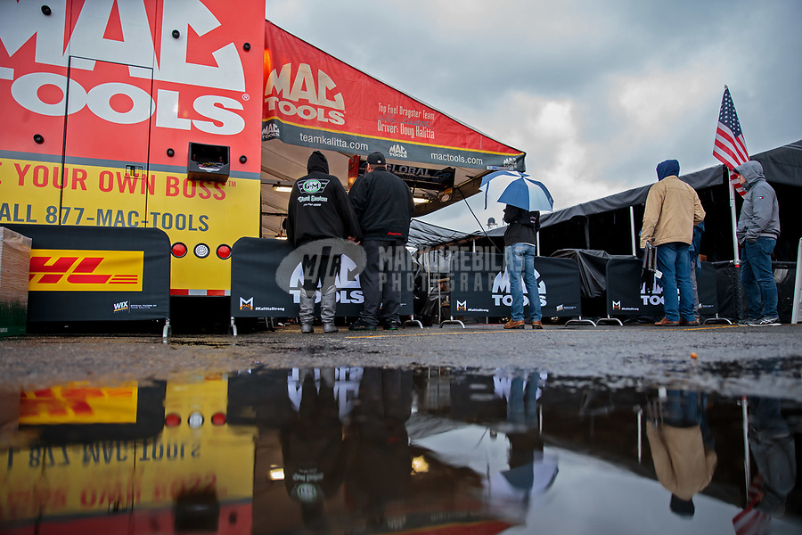 Feb 10, 2019; Pomona, CA, USA; Rain water puddles near the pit area of NHRA top fuel driver Doug Kalitta during a rain delay to the Winternationals at Auto Club Raceway at Pomona. Mandatory Credit: Mark J. Rebilas-USA TODAY Sports