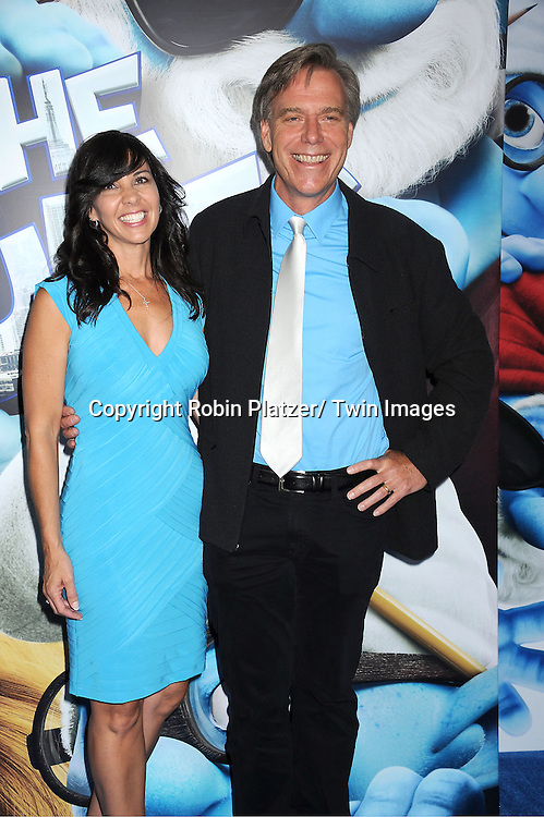 "the director Raja Gosnell and his wife attending The World Premiere of ""The Smurfs"" on .July 24, 2011 at The Ziegfeld Theatre in New York City. .The movie stars Neil Patrirck Harris, Katy Perry, Sofia Vergara, Jayma Mays, Hank Azaria, George Lopez, Alan Cumming, Jeff Foxworthy and Tim Gunn."