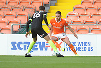 Blackpool's Oliver Turton under pressure from Macclesfield Town's Corey O'Keeffe<br /> <br /> Photographer Kevin Barnes/CameraSport<br /> <br /> The Carabao Cup First Round - Blackpool v Macclesfield Town - Tuesday 13th August 2019 - Bloomfield Road - Blackpool<br />  <br /> World Copyright © 2019 CameraSport. All rights reserved. 43 Linden Ave. Countesthorpe. Leicester. England. LE8 5PG - Tel: +44 (0) 116 277 4147 - admin@camerasport.com - www.camerasport.com