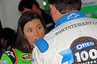 Danica Patrick (#10) talks with team owner Tony Stewart (#14) in the garage.
