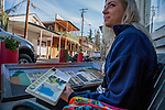 California Delta town of Locke, Wednesday, January, 28, 2015.  Local artist Mary Sand works on a painting of the main street buildings of Locke.  Photo/Victoria Sheridan