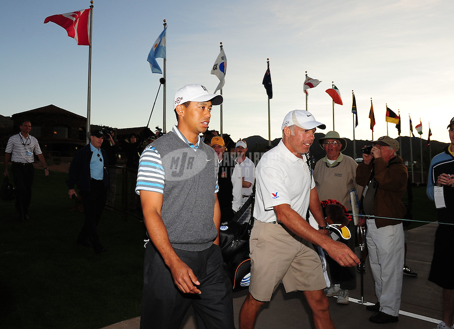 Feb 24, 2009; Marana, AZ, USA; Tiger Woods (left) walks with caddie Steve Williams during a practice round prior to the World Golf Championships-Accenture Match Play Championship at the Ritz-Carlton Golf Club, Dove Mountain.  Mandatory Credit: Mark J. Rebilas-