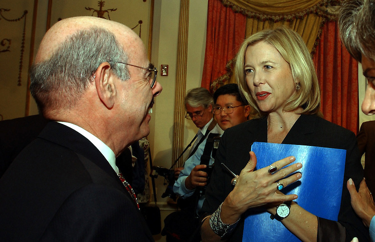 8reception -- Annette Bening talks with Henry Waxman, D-CA., during a reception to kick off the new political group, Progressive Majority.