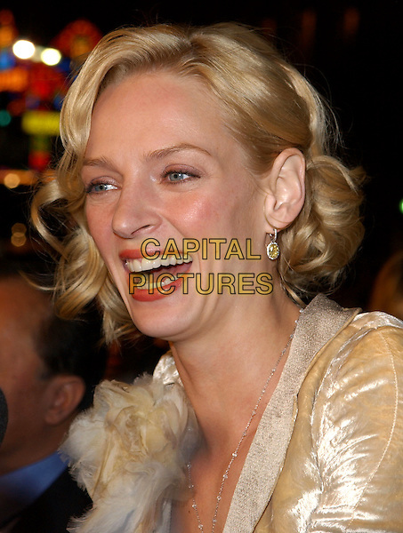 UMA THURMAN.L.A. Premiere of Paycheck held at The Graumann's Chinese Theatre in Hollywood .18 December 2003 .*UK Sales Only*.headshot, portrait, laughing                                                .www.capitalpictures.com.sales@capitalpictures.com.©Capital Pictures.
