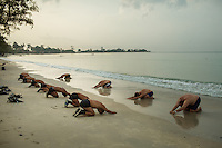 14 February, 2013 - Sihanoukville (Cambodia). Deminers from the Cambodian Mine Action Center (CMAC) practice stretching on the shore of Independence Beach - Sihanoukville. © Thomas Cristofoletti / Ruom