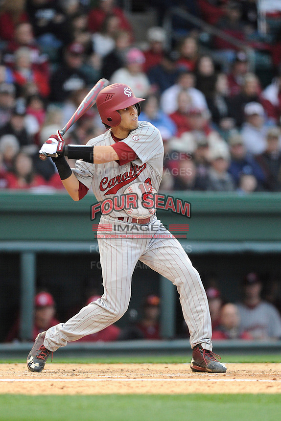 Catcher Dante Rosenberg (18) of the South Carolina Gamecocks bats in a game against the Furman Paladins on Wednesday, April 3, 2013, at Fluor Field at the West End in Greenville, South Carolina. (Tom Priddy/Four Seam Images)