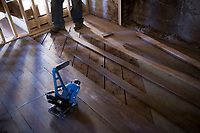 NWA Democrat-Gazette/CHARLIE KAIJO 100-year-old flooring is removed so workers can replace the subfloor, Thursday, February 8, 2018 at the old Dollar Saver building in Rogers.<br />