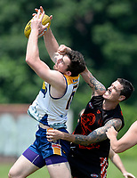 DC's Sam Rowley (16) marks over top of Baltimore's Bryn Hansen (15) as Hansen (15) tries to punch the ball away. The DC Eagles defeated the Baltimore Dockers 51-40 in their USAFL game 6-9-18 in Baltimore, MD.