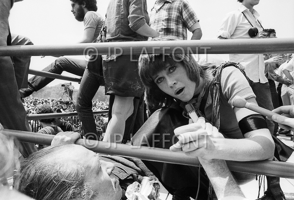 09 May 1970, Washington, DC, USA --- Political activist Jane Fonda is interviewed by Georges Vikar (Europe 1) at a demonstration in Washington, DC, where over 100,000 students are protesting the recent violence used to breakup a Vietnam War protest at Kent State University. Four Kent State students were killed, and many others injured, when members of the National Guard fired tear gas and rifles into crowds of student demonstrators who were protesting the Nixon administration's expansion of the Vietnam War into Cambodia.
