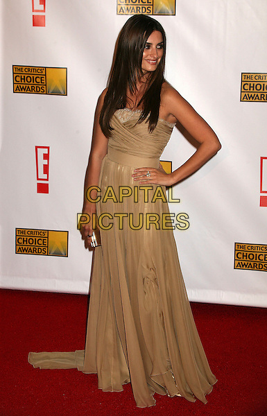 PENELOPE CRUZ.At The 12th Annual Broadcast Film Critics Choice Awards held at The Santa Monica Civic Auditorium in Santa Monica, California, LA, USA, January 12th 2007. .full length gold dress hand on hip.CAP/ADM/BP.©Byron Purvis/AdMedia/Capital Pictures.
