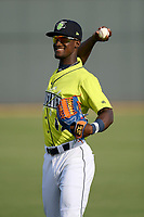 Center fielder Gerson Molina (12) of the Columbia Fireflies warms up before a game against the Augusta GreenJackets on Thursday, July 11, 2019 at Segra Park in Columbia, South Carolina. Columbia won, 5-2. (Tom Priddy/Four Seam Images)