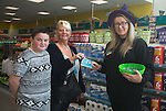 Dealz Fonthill Road . Tagdh Fitzgerald and his mum Anita Fitzgerald , from Clondalkin , with Megan Killeen (Staff).