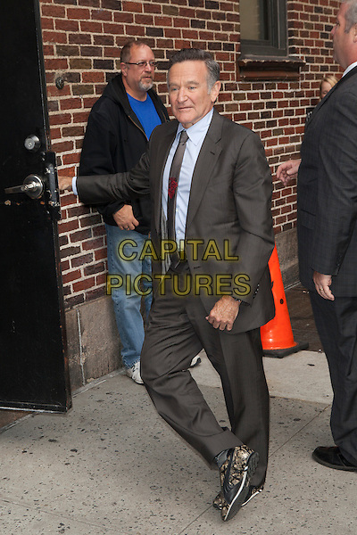 Robin Williams<br /> visits the Late Show With David Letterman, New York City, New York, USA.<br /> September 25th, 2013 <br /> full length grey gray suit  <br /> CAP/MPC/COR<br /> &copy;Corredor99/ MediaPunch/Capital Pictures