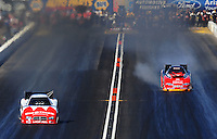 Oct. 15, 2011; Chandler, AZ, USA; NHRA funny car driver Jeff Diehl (right) backfires the supercharger while racing alongside Johnny Gray during qualifying at the Arizona Nationals at Firebird International Raceway. Mandatory Credit: Mark J. Rebilas-