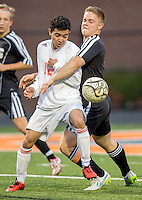 NWA Democrat-Gazette/JASON IVESTER --03/20/2015--<br /> Rogers Heritage sophomore Angel Castro (left) tries to get around the defense from Bentonville senior Bennett Moehring (cq) during the first half on Friday, March 20, 2015, at David Gates Stadium in Rogers.