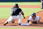 28 May 2016: Franklin Pierce's Justin Brock (right) beats the pickoff tag from Nova Southeastern's Andres Visbal (10) back to first base. The Nova Southeastern University Sharks played the Franklin Pierce University Ravens in Game 3 of the 2016 NCAA Division II College World Series  at Coleman Field at the USA Baseball National Training Complex in Cary, North Carolina. Nova Southeastern won the game 4-3 in twelve innings.