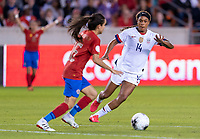 HOUSTON, TX - FEBRUARY 03: Jess McDonald #14 of the United States closes in on Katherine Alvarado #16 of Costa Rica during a game between Costa Rica and USWNT at BBVA Stadium on February 03, 2020 in Houston, Texas.