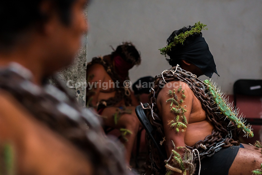 Hooded Catholic penitents, wearing heavy chains and cactus spines stuck to their bodies, prepare to take part in the Holy week procession in Atlixco, Mexico, 30 March 2018. Every year on Good Friday, dozens of anonymous men of all ages voluntarily undergo pain and suffering during the religious procession of the 'Engrillados' (the Shackled ones) in Puebla state, central Mexico. Wearing heavy chains on their shoulders covered with prickling cacti while being burned by the hot midday sun, they recall Jesus Christ's death by crucifixion and demonstrate their religiosity and faith.