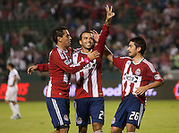 Chivas USA midfielder Rodolfo Espinosa (24) celebrates his goal with Jesus Padilla (10) and Paulo Nagamura (26) during the second half of the game between Chivas USA and Toronto FC at the Home Depot Center in Carson, CA, on October 9, 2010. Final score Chivas USA 3, Toronto FC 0.