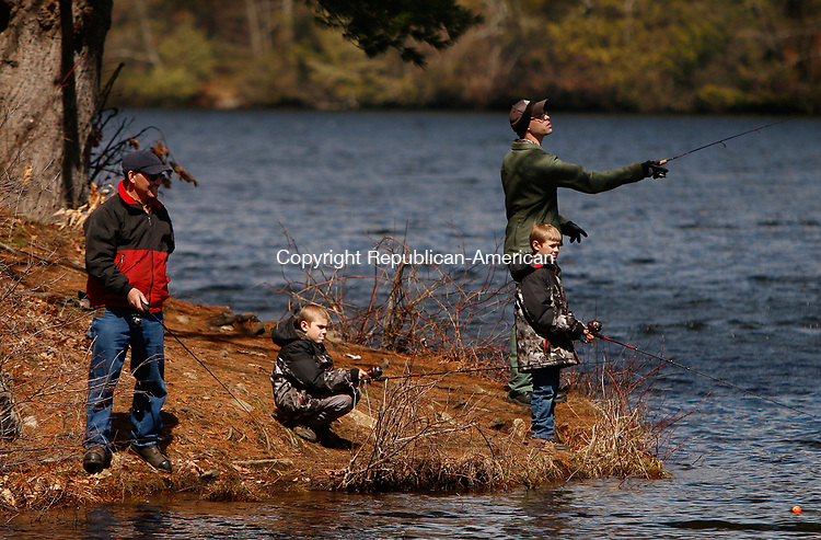 Torrington, CT 040817MK01 (from left) Michael Maccalous with his grandsons Matt and Nate with their dad Michael Maccalous cast their lines in Stillwater pond in the Drakeville section of Torrington Saturday afternoon.  Saturday was the opening day of trout season and traditional first day of fishing in Connecticut. Michael Kabelka / Republican-American