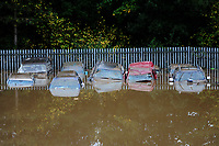 Pictured: Flooding caused by Storm Callum, outside Ken Williams Motors in Carmathen, Wales, UK. Sunday 14 October 2018<br /> Re: The aftermath of the flood caused by the unusually high tide of rover Towy and storm Callum in Carmarthen west Wales, UK.
