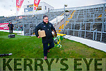 Kerry County Board Assistant Secretary Stephen O' Sullivan leaves with the Bishop Moynihan Cup at the end of the Kerry County Senior Football Final at Fitzgerald Stadium on Sunday.