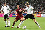 08 July 2006: Marcell Jansen (GER) (2) is challenged for the ball by Cristiano Ronaldo (POR) (17). Germany defeated Portugal 3-1 at the Gottlieb-Daimler Stadion in Stuttgart, Germany in match 63, the third-place game, of the 2006 FIFA World Cup.