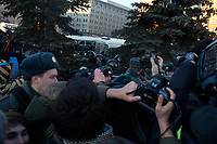 Russian opposition political activist Alexey Navalny speaks to reporters and prepares for his arrest during an unsanctioned anti-Putin demonstration in Lubyanka Square in central Moscow, Russia. Moments after this photo, police grabbed Navalny from the crowd and arrested him.  He was later released.  The protests come a year after protests in 2011 calling for fair elections and an end to corruption in Russia.  Navalny, a lawyer and political and economic activist, is known for his political blog on livejournal, which he has used to organize anti-corruption and anti-Putin demonstrations.