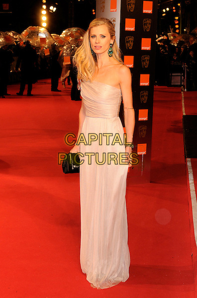 LAURA BAILEY .The Orange British Academy Film Awards 2009, Royal Opera House, Covent Garden, London, England, February 8th 2009..BAFTAS arrivals full length one shoulder white silver long maxi dress black clutch bag .CAP/FIN.©Steve Finn/Capital Pictures