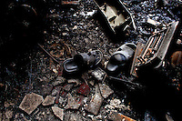 Shoes of victims who either died or who managed to escape by jumping from the building during the blaze. At least 112 people died, and more than 100 were injured at a fire at the Tazreen Fashions textile factory in Dhaka. Bangladesh's garment industry has a notoriously bad fire safety record; if the right precautions had been taken, the fire could have been prevented.