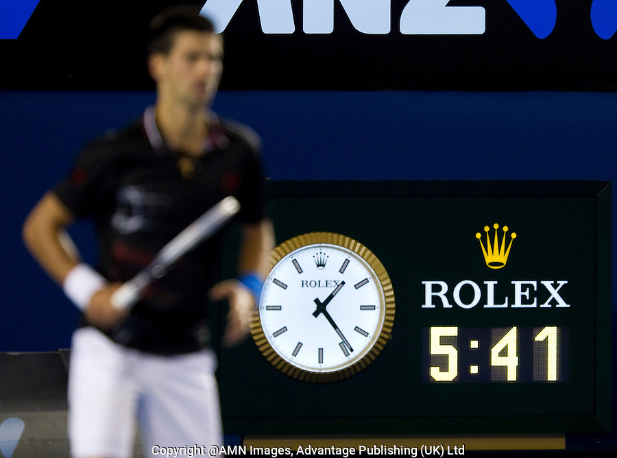 NOVAK DJOKOVIC (SRB) against RAFAEL NADAL (ESP) in the FINAL of the Men's Singles. Novak Djokovic Beat Rafael Nadal 5-7 6-4 6-2 6-7 7-5...29/01/2012, 29th January 2012, 29.01.2012 - Day 14..The Australian Open, Melbourne Park, Melbourne,Victoria, Australia.@AMN IMAGES, Frey, Advantage Media Network, 30, Cleveland Street, London, W1T 4JD .Tel - +44 208 947 0100..email - mfrey@advantagemedianet.com..www.amnimages.photoshelter.com.