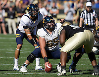 Dominic Galas of California talks with Zach Maynard of California during the game against Colorado on Folsom Field at Boulder, Colorado on September 10th, 2011.  California defeated Colorado, 36-33 at overtime.