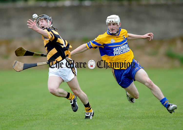 Tubber's Clive Earley is tackled by Sixmilebridge's Danny Morey during their championship game at Tulla. Photograph by John Kelly.