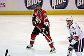 February 22nd 2008:  Derek Smith (24) of the Binghamton Senators skates up ice during a game vs. the Rochester Amerks at Blue Cross Arena at the War Memorial in Rochester, NY.  The Senators defeated the Amerks 4-0.   Photo copyright Mike Janes Photography