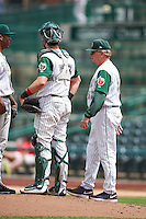 Fort Wayne TinCaps pitching coach Burt Hooton (32) talks with starting pitcher Austin Smith (9) and catcher Austin Allen (23) during the second game of a doubleheader against the Great Lakes Loons on May 11, 2016 at Parkview Field in Fort Wayne, Indiana.  Great Lakes defeated Fort Wayne 5-0.  (Mike Janes/Four Seam Images)