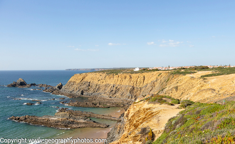Rocky coastal landscape Praia dos Alteirinhos beach in bay with rocky headland part of Parque Natural do Sudoeste Alentejano e Costa Vicentina, Costa Vicentina and south west Alentejo natural park, Zambujeira do Mar, Alentejo  Littoral, Portugal, southern Europe