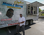 Stephon Van Dyke with his Mobile Bistro truck during Sizzling Saturdays Food Truck event in Sparks on Saturday, July 20, 2019.