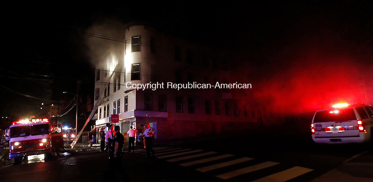 Waterbury, CT-27, May 2010-052710CM21 Fire officials work a scene on Colley St. across the entrance to Waterbury Hospital late Thursday evening.  A fire hit several apartments on this vacant building.   --Christopher Massa Republican-American