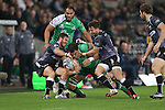 Osprey pair Martin Roberts and Tom Grabham haul down Connacht lock Quinn Roux.<br /> Guiness Pro12<br /> Ospreys v Connacht<br /> Liberty Stadium<br /> 31.10.14<br /> &copy;Steve Pope-SPORTINGWALES