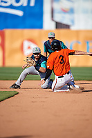 Lynchburg Hillcats second baseman Dillon Persinger (38) tags Cole Billingsley (3) on a stolen base attempt as shortstop Luke Wakamatsu (12) looks on during the first game of a doubleheader against the Frederick Keys on June 12, 2018 at Nymeo Field at Harry Grove Stadium in Frederick, Maryland.  Frederick defeated Lynchburg 2-1.  (Mike Janes/Four Seam Images)