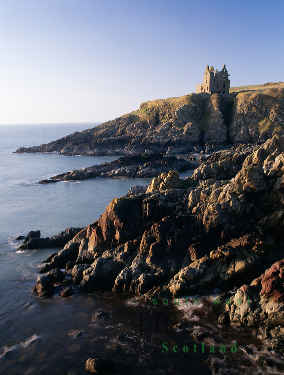 Dunskey Castle high on the cliffs above the sea looking up the North Channel to Ireland near Portpatrick Galloway Scotland UK