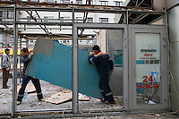 Moscow, Russia, 14/11/2010..City workers tear down kiosks near a metro station after new Mayor Sergei Sobyanin ordered the removal of hundreds of the structures, mainly in the city centre. The kiosks, which are ubiquitous throughout the Russian capital, appeared after the fall of the Soviet Union in response to consumer demand and sell a wide range of goods, but most specialise in foodstuffs, alcohol and tobacco.