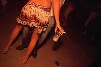 Below the full moon on a night in the southern summer, dancers spin at the Forró da Lua, or Forró of the Moon, on a ranch near São José de Mipibu, Brazil, Saturday, January 14, 2006. (Kevin Moloney for the New York Times)