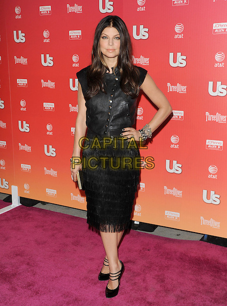 """FERGIE  - STACY ANN FERGUSON.at The 2009 US Weekly Annual """"Hot Hollywood"""" Party held at My House in Hollywood, California, USA,.April 22nd 2009.                                                                     .full length black leather vest top studded tassels skirt dress shoes fringed hand on hip triple strap mary janes sleeveless .CAP/DVS.©Debbie VanStory/RockinExposures/Capital Pictures"""