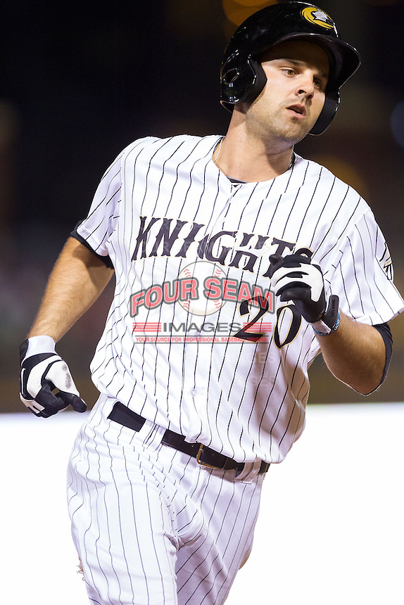 Jordan Danks (20) of the Charlotte Knights rounds the bases after hitting a home run against the Rochester Red Wings at BB&T Ballpark on June 5, 2014 in Charlotte, North Carolina.  The Knights defeated the Red Wings 7-6.  (Brian Westerholt/Four Seam Images)