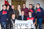 Over €1900 was collected from a Tractor Run charity event organised by Mid Kerry Macra Na Féirme last March, starting at the Miltown mart and kindly handed over to Shelia Kelliher ( seated front ) treasurer of  Killorglin Mental Health last Friday night in O'Shea's bar, Miltown, also seated is Pat O'Brien ( centre ) chairperson of the Kerry Mental Health Association and Shane Clifford, Chairperson of the Mid Kerry Macra, back L-R Sean Joy, Jonathan Kelleher, John McCarthy, Zeta Ashe, Dan Horgan, Niall Flahive and Trevor Coffey.